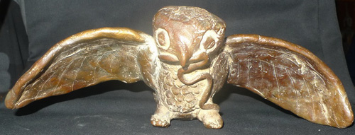 Owl with snake lucky charm