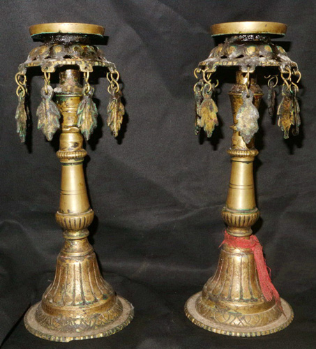 Pair of candlesticks / oil lamps
