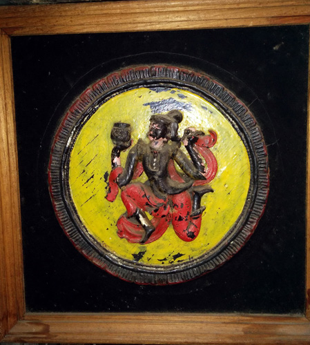 Framed Buddhist wood carving