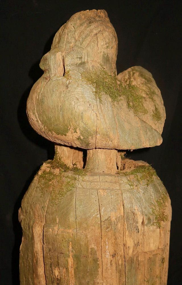 Folk bird on wooden base