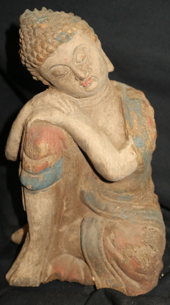Chinese Buddha sitting in a strange position