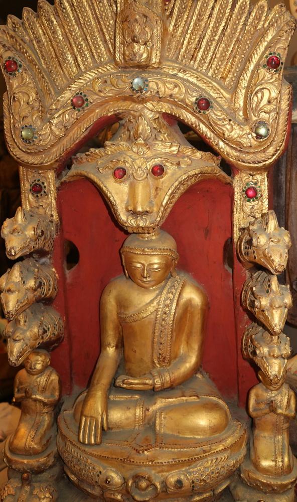 Buddha decorated w. nats, mythological animals, etc.