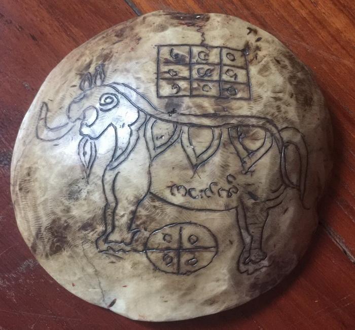 Tiny carved kapala