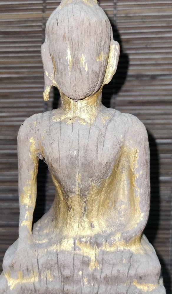 Damaged folk Buddha