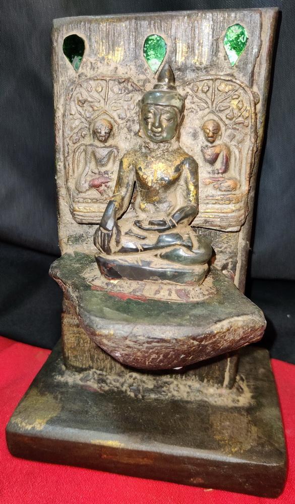 Buddha on  base - stone