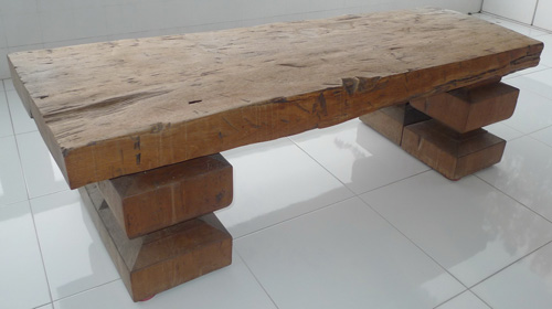 Piece of wood used as a table w/ recent feet