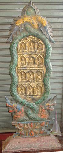 Votive Buddhist plaque w/ Buddha images and naga