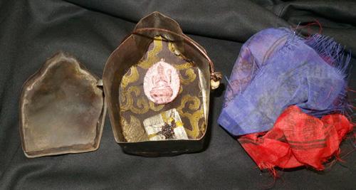 Yamataka gau with magic texts and Buddha